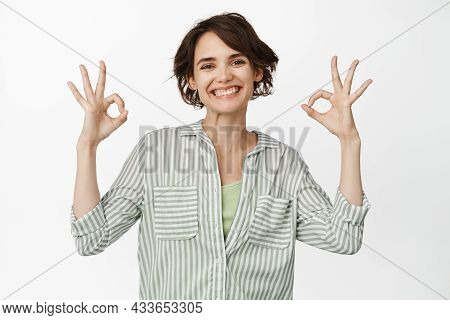 Satisfied Modern Girl Showing Okay, Ok Sign, Recommending Smth, Praise And Compliment, Standing Agai