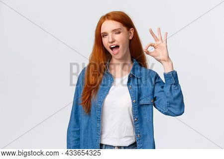 Waist-up Portrait Cheeky, Confident And Relaxed, Chill Redhead Woman Saying All Alright, Encourage E