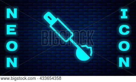 Glowing Neon Measuring Spoon Icon Isolated On Brick Wall Background. Vector