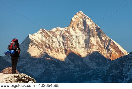 Mount Nanda Devi, One Of The Best Mounts In Indian Himalayas, Seen From Joshimath Auli, With Tourist