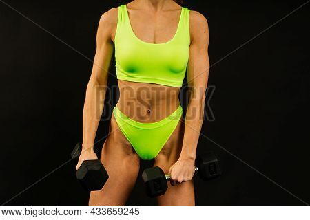 Young Beautiful Sporty Muscular Woman, Isolated Against White And Black Background
