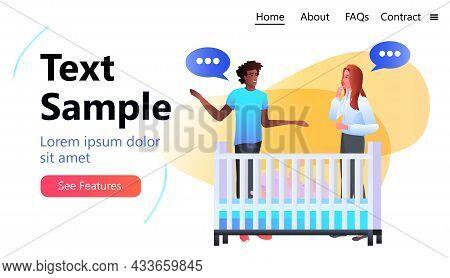 Mix Race Parents Discussing Near Crib Chat Bubble Communication Parenting Concept