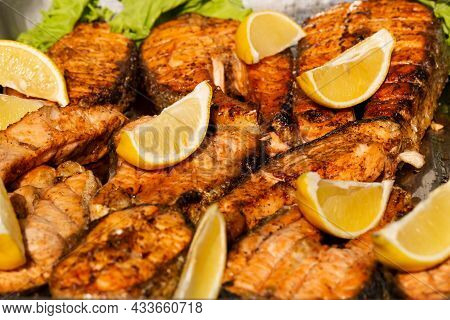 Delicious Grilled Salmon. Garnished With Lemon Wedges. Top View