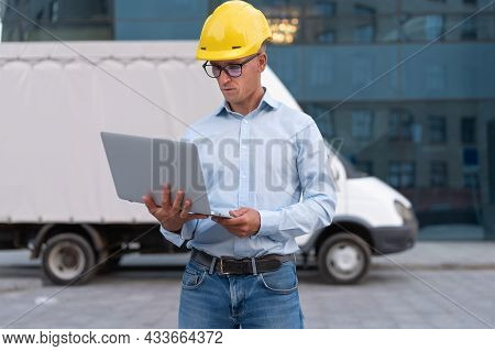 Business. Engineer Worker Protective Helmet Use Laptop Controls Working Process Inspector Supervisor