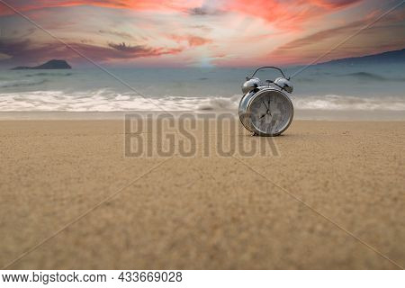 Analog Clock Marking The Time Of The Tides In The Sand On The Shore Of The Beach With Time Copy