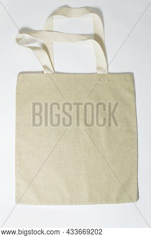 Eco-friendly Empty Beige Canvas Bag On Gray Background. Reusable Bag For Groceries And Shopping. Des