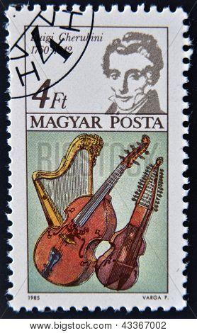 stamp printed in Hungary shows Luigi Cherubini Harp Bass Viol and Baryton