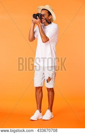 Full-length Vertical Shot African American Male Tourist Taking Pictures Of Sightseeing, Looking In C