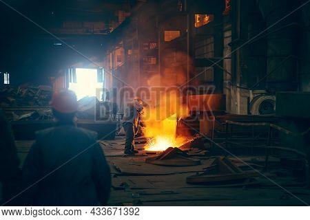Worker In Blast Furnace. Metallurgical Plant. Industrial Steel Production. Interior Of Metallurgical