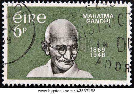 A stamp printed in Ireland shows Mahatma Gandhi