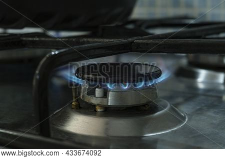 Lpg Propane Gas Cooker Close Up While Burning, Not Renewable Energy Wastage