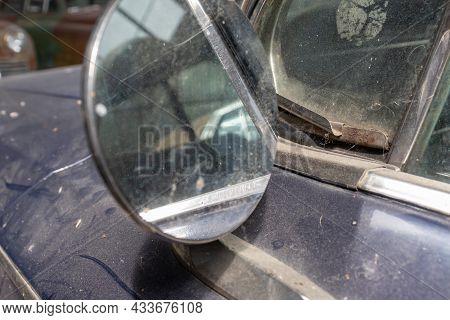Side Mirror Of Old Abandoned Rusty Vehicles, Crushed Cars In Scrapyard, Junk Yard Needed To Be Utili