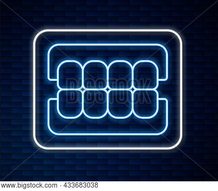 Glowing Neon Line False Jaw Icon Isolated On Brick Wall Background. Dental Jaw Or Dentures, False Te