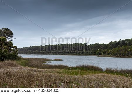 Large Lagoon Just Inland Of Oceanfront On A Stormy Day, Dark Overcast Skies, Hunting Island South Ca