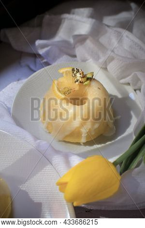 Lemon Cake With Yellow Tulip, Classic Recipe, Decorated With Sugar Icing In White Ceramic Plate On T