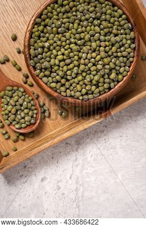 Raw Mung Bean On Wooden Table Background.
