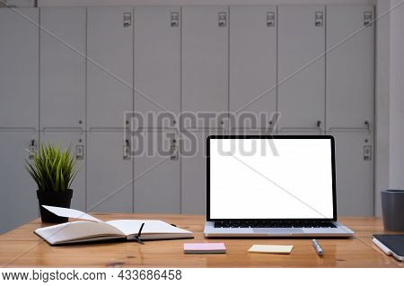 Image Of Mock Up Laptop Computer On Wooden Desk In Office. Blank Screen For Your Advertising