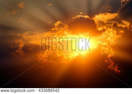 Sunlight sun rays shining through clouds in sky symbolizing hope and redemption