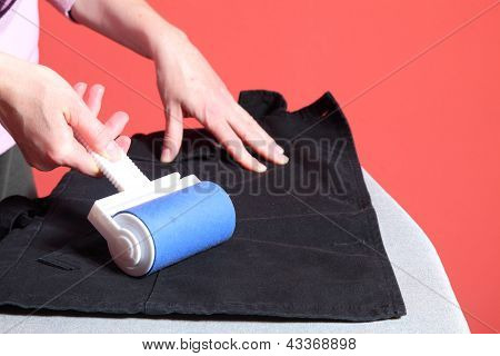 Cleaning Dust With Lint Roller