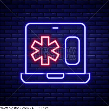 Glowing Neon Line Medical Clinical Record On Laptop Icon Isolated On Brick Wall Background. Health I