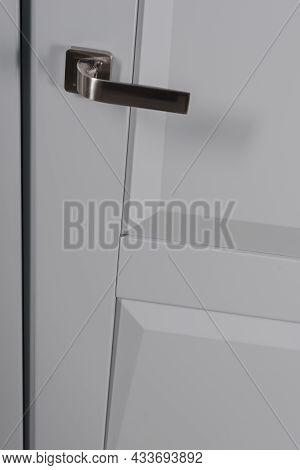 Gray Entrance Door With Modern Chrome Door Knob