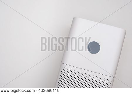 Indoor Air Purifier Of White Color Close-up On A White Background. Dust And Allergy Cleaner In The H