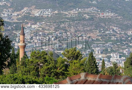 Minaret On The Background Of City Streets In Alanya, Turkey