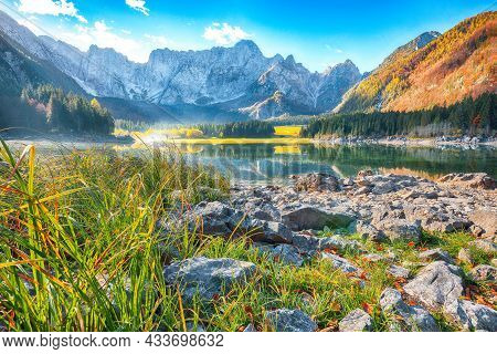 Astonishing View Of Fusine Lake With Mangart Peak On Background. Popular Travel Destination Of Julia