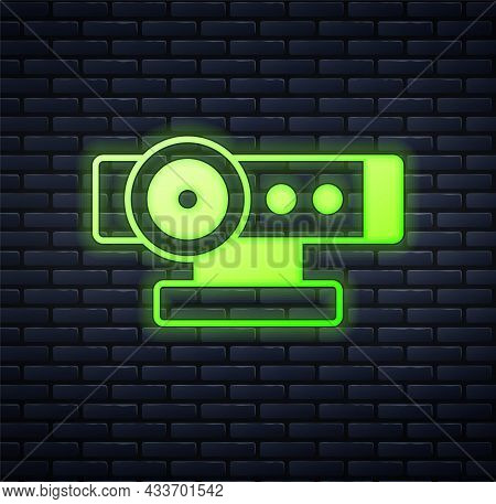 Glowing Neon Web Camera Icon Isolated On Brick Wall Background. Chat Camera. Webcam Icon. Vector
