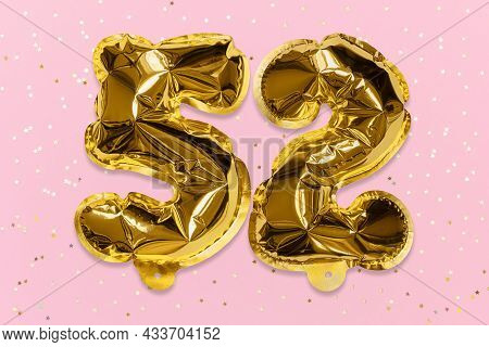 The Number Of The Balloon Made Of Golden Foil, The Number Fifty-two On A Pink Background With Sequin