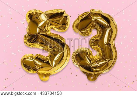 The Number Of The Balloon Made Of Golden Foil, The Number Fifty-three On A Pink Background With Sequ