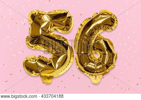 The Number Of The Balloon Made Of Golden Foil, The Number Fifty-six On A Pink Background With Sequin