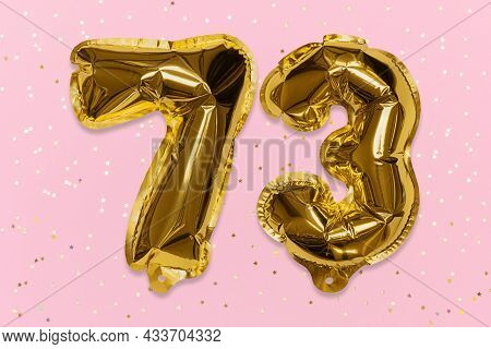 The Number Of The Balloon Made Of Golden Foil, The Number Seventy-three On A Pink Background With Se