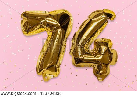 The Number Of The Balloon Made Of Golden Foil, The Number Seventy-four On A Pink Background With Seq
