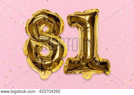 The Number Of The Balloon Made Of Golden Foil, The Number Eighty-one On A Pink Background With Sequi