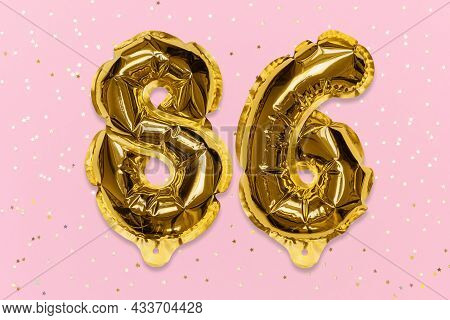 The Number Of The Balloon Made Of Golden Foil, The Number Eighty-six On A Pink Background With Sequi