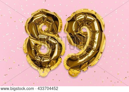 The Number Of The Balloon Made Of Golden Foil, The Number Eighty-nine On A Pink Background With Sequ