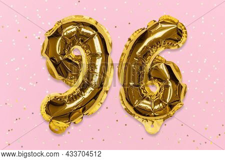 The Number Of The Balloon Made Of Golden Foil, The Number Ninety-six On A Pink Background With Sequi