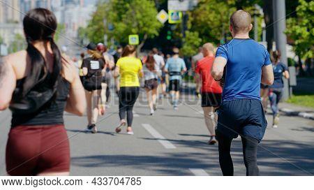 Crowd Of People Running Marathon During Pandemic