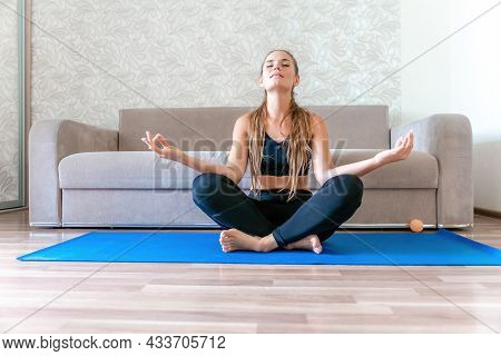 Young Woman With Long Hair, Fitness Instructor In Black Sportswear, Doing Stretching And Pilates On