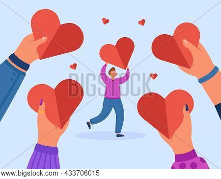 Hands Of Group Of People Holding Hearts For Tiny Man. People Making Donations To Charity Foundation