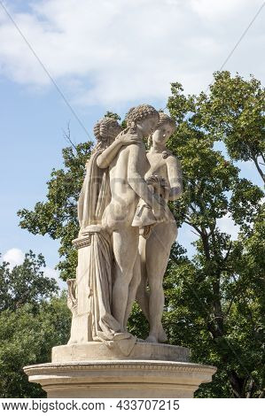 The Statue Of The Three Graces Is Located In Front Of The Church Of The Three Graces, Which Is A Pro