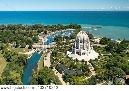 Wilmette, IL - September 9, 2021: Aerial view of the Baha'i Temple and Wilmette Harbor in Wilmette, IL on a beautiful later summer day.