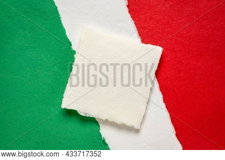blank square sheet of paper against abstract in colors of national flag of Italy (green, white and red), collection of handmade rag paper sheets