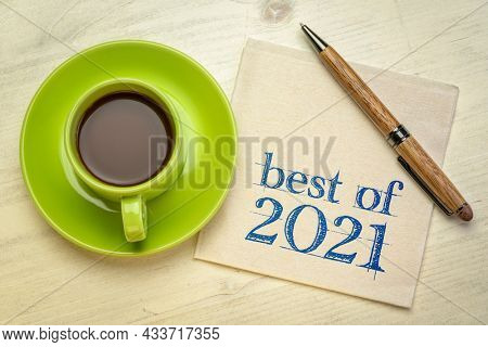 best of 2021 -  handwriting on a napkin with a cup of coffee, product or business review of the recent year