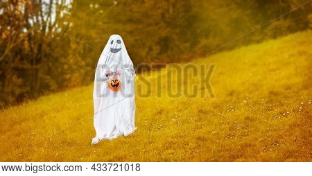 Child Dressed Up As Ghost For Halloween, Kid Costume Of A Ghost, Outdoor Shoot, Natural Background.