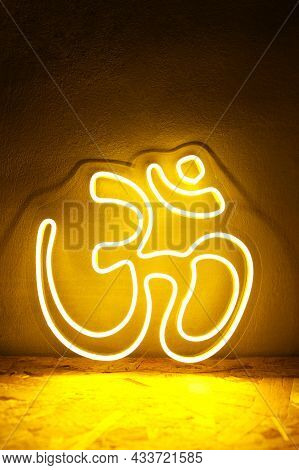 Yellow Neon Sign Om. Om Symbol Glow Background. Hindu Religion. Trendy Style. Neon Sign. Custom Neon