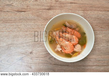 Boiled River Shrimp With Herb In Thai Spicy Soup Or Tom Yum Kung On Bowl