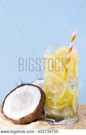 Coconut And Lemonade On Sandy Beach. Travel And Beach Vacation.