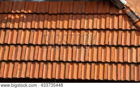 Roof Tile. Tile Roof Of A Old House. Tile Roofs Used In Old And Modern Style Construction For Safety